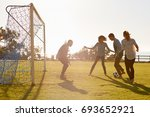 young adults playing football... | Shutterstock . vector #693652921