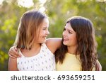 portrait of two smiling young... | Shutterstock . vector #693659251