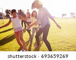two families in a park playing... | Shutterstock . vector #693659269