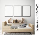 mock up poster frames in... | Shutterstock . vector #693670405