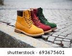 winter boots. on the sidewalk | Shutterstock . vector #693675601