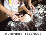 mother and daughter cooking at... | Shutterstock . vector #693678079