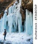 a man look into little frozen... | Shutterstock . vector #693680569