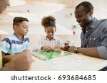 african american family playing ... | Shutterstock . vector #693684685