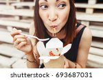 beautiful woman are eating... | Shutterstock . vector #693687031