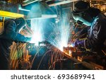 worker  welding in a car... | Shutterstock . vector #693689941