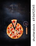 traditional italian pizza on a... | Shutterstock . vector #693692545