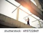 asian engineers on the building ... | Shutterstock . vector #693722869