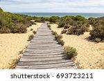 wooden walkway in the asperillo ... | Shutterstock . vector #693723211