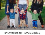 mothers holding sons by hand | Shutterstock . vector #693725017