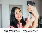 beautiful happy indian womanl... | Shutterstock . vector #693733597
