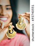 young beautiful indian woman ... | Shutterstock . vector #693740551