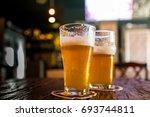 couple of craft beer glasses | Shutterstock . vector #693744811