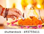 hindu ceremony. puja   offering ... | Shutterstock . vector #693755611