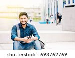 happy indian male student... | Shutterstock . vector #693762769