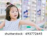 little child choosing food in... | Shutterstock . vector #693772645