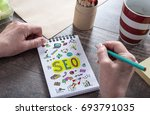 seo concept drawn on a notepad | Shutterstock . vector #693791035