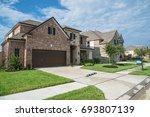 suburban american neighborhood... | Shutterstock . vector #693807139