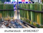 cooking lemang  a type of... | Shutterstock . vector #693824827