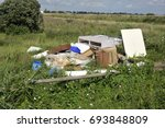 fly tipped household furniture  ... | Shutterstock . vector #693848809