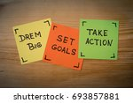 Small photo of Dream big, set goals, take action, success recipe on wooden background. dream big, set goals, take action - motivational advice or reminder on colorful sticky notes against rustic wood