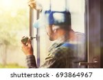 service man installing window... | Shutterstock . vector #693864967