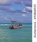 Small photo of Typical mexican panga fishing boat, , Playa del Carmen, Mexico