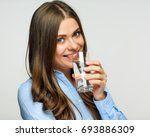 woman drinking water with glass.... | Shutterstock . vector #693886309