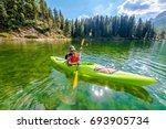 Shallow Scenic Lake Kayak Tour. Caucasian Kayaker on the Lake Misurina in Northern Italy. Italian Dolomites. - stock photo