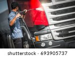 truck driver washing his semi... | Shutterstock . vector #693905737