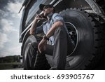 Truck Parts Ordering by Driver. Caucasian Truck Driver Ordering New Parts For His Truck by Phone. - stock photo