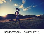 young fitness woman runner... | Shutterstock . vector #693911914