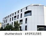 modern apartment building... | Shutterstock . vector #693931585