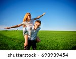 smiling man is holding on his... | Shutterstock . vector #693939454