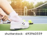 tennis player is putting shoe... | Shutterstock . vector #693960559