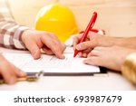 woman signing construction... | Shutterstock . vector #693987679