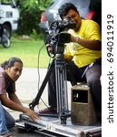 Small photo of MALAYSIA, 11 August 2017- Cameraman using a camcorder filming tele movie of television programe with the dolly man at Hulu Langat 40 km from Kuala Lumpur.