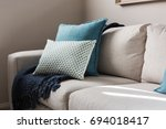close up of a fabric sofa with... | Shutterstock . vector #694018417
