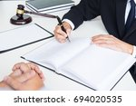 business people and lawyers... | Shutterstock . vector #694020535