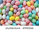Jelly bean background.  Close-up of speckled, pastel colored jelly beans. - stock photo