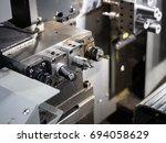 operator machining automotive... | Shutterstock . vector #694058629