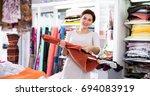 young woman choosing...   Shutterstock . vector #694083919