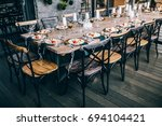 food on the buffet table ... | Shutterstock . vector #694104421