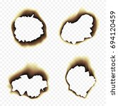 scorched holes in the paper.... | Shutterstock . vector #694120459