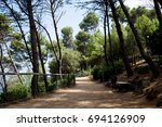 the green park zone of montjuic ... | Shutterstock . vector #694126909