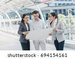 three people are business...   Shutterstock . vector #694154161