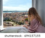Woman Sitting On The Bed In Th...