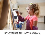 artist school girl painting... | Shutterstock . vector #694160677