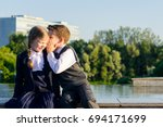 Small photo of Children of school age tell each other their secrets