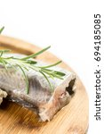Small photo of Raw hake fish with rosemary and copy space white background.